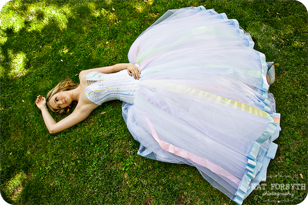 Bride lying on grass