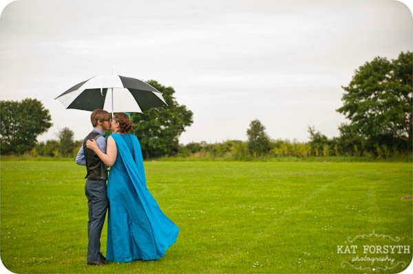 Rainy green field umbrella turquoise wedding dress