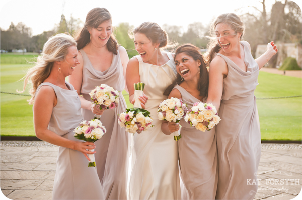 Laughing bridesmaids pale pink dresses
