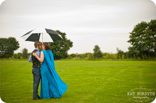 wedding rainy green fields black white umbrella