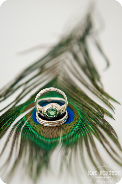 Tormaline wedding ring on peacock feather