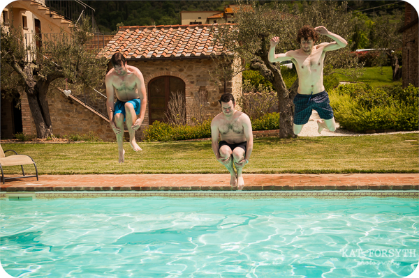 Groomsmen jumping into pool