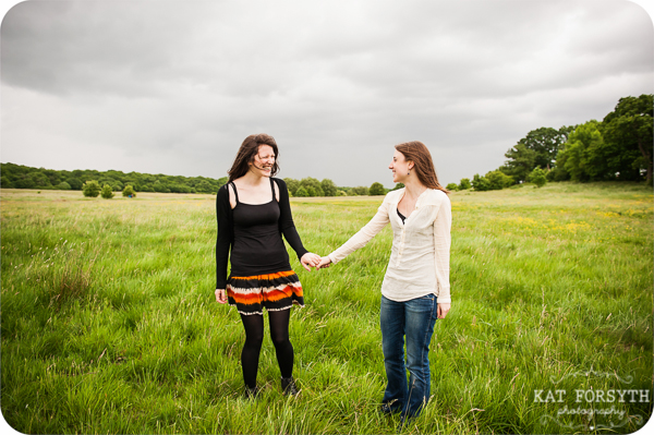 Gay lesbian engagement couple photo green field