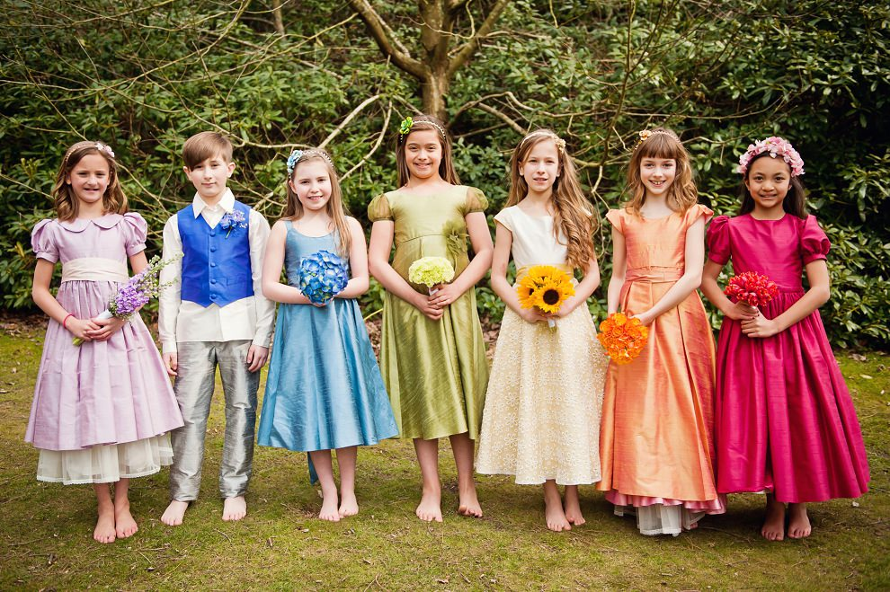 Flowergirls in rainbow dresses