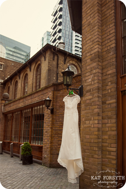 Wedding dress hanging outside hotel