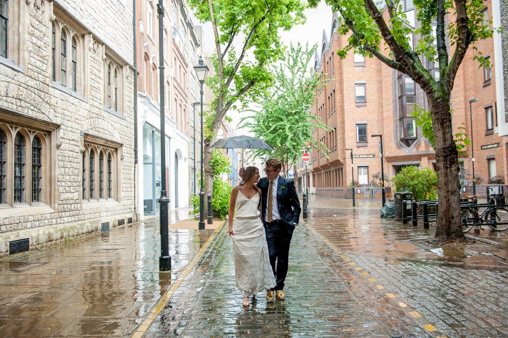 bride and groom in the rain, London wedding