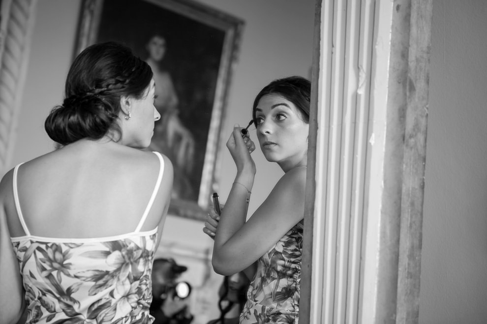 Bride getting ready at Aynhoe Park in the mirror