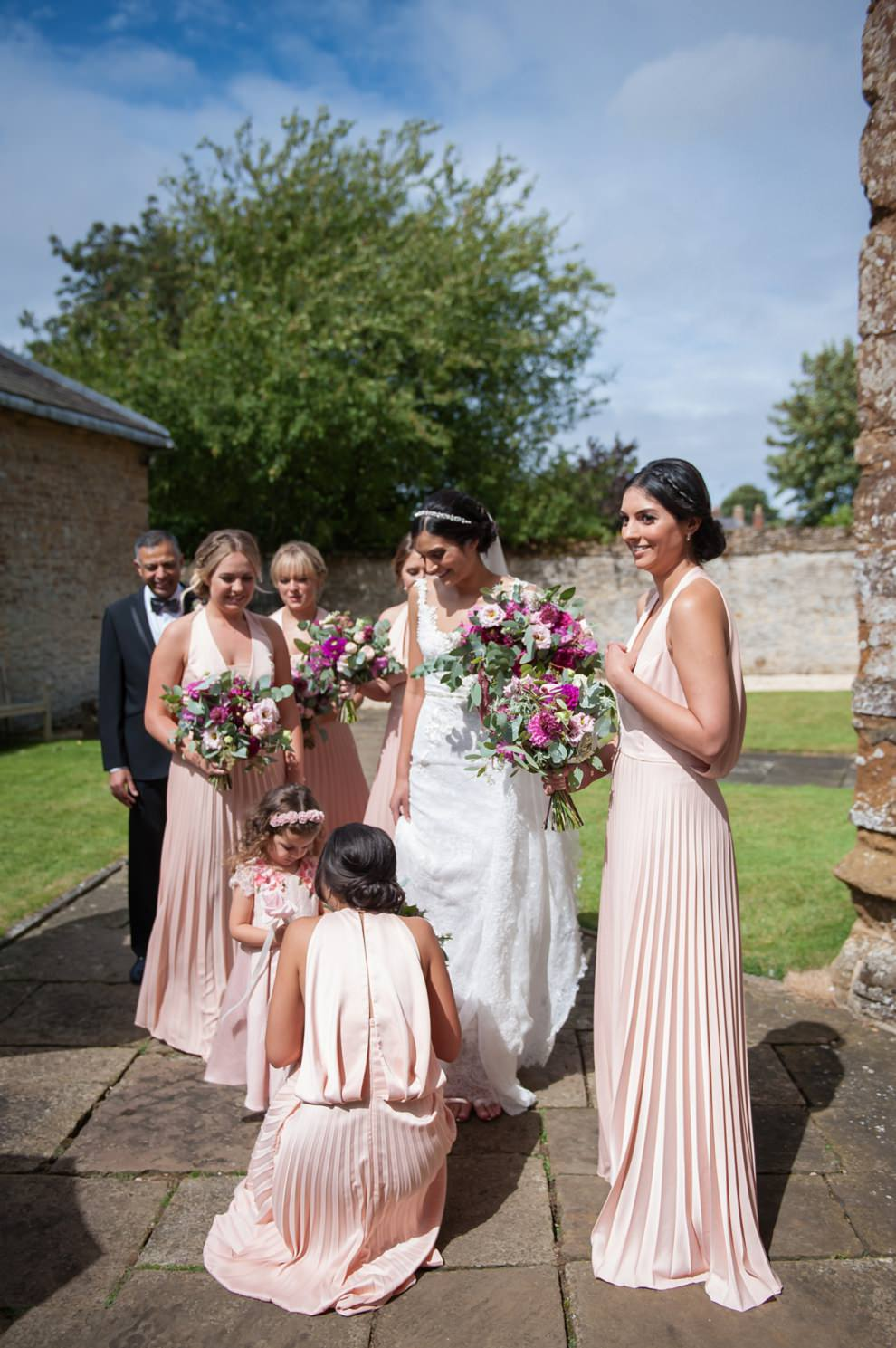 Bridesmaids in pink dresses outside church