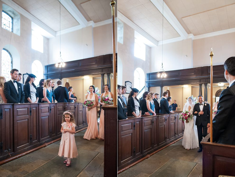 Bride and bridesmaids walking down the aisle at Aynhoe Park church