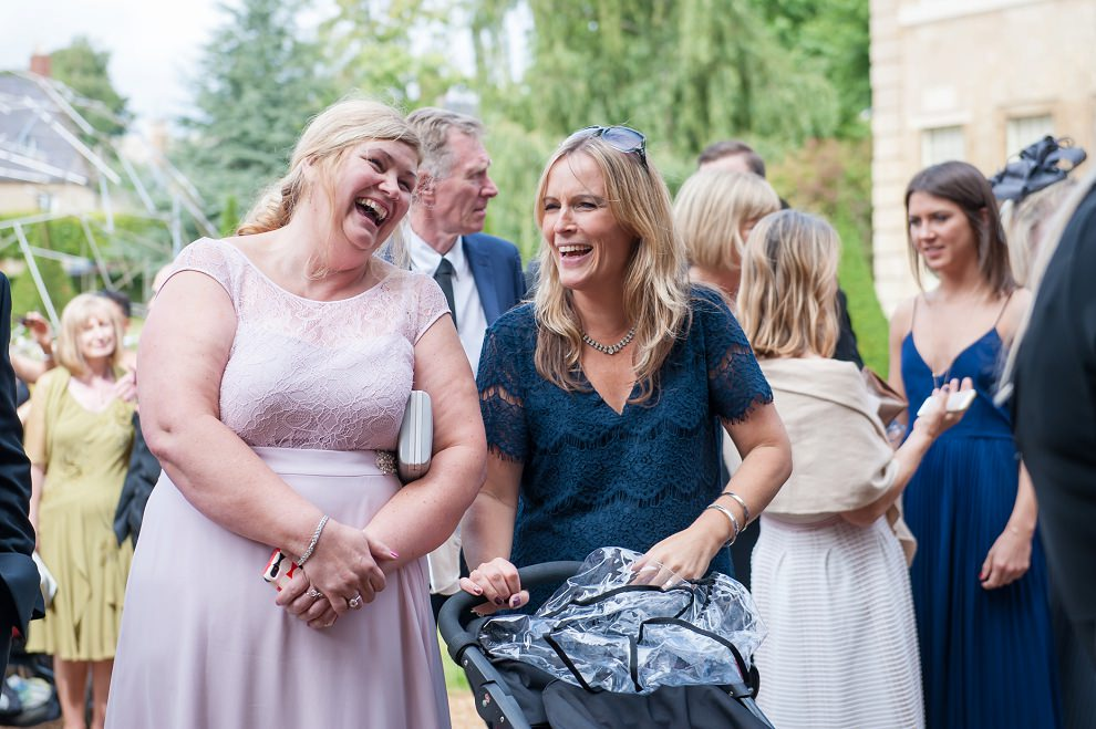 Candid photo of wedding guests laughing