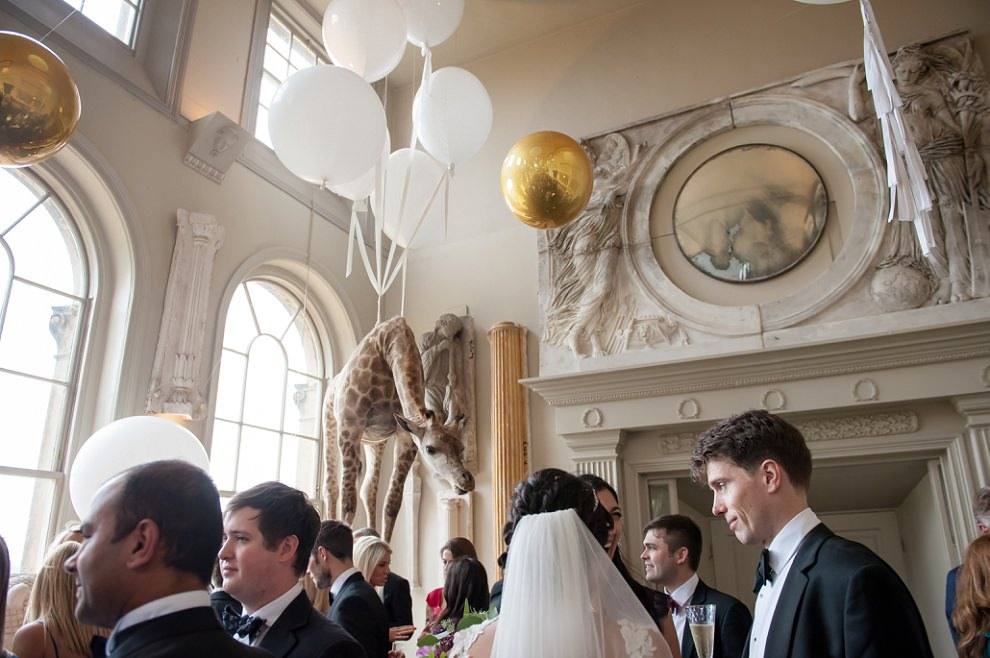 Balloons and floating stuffed giraffe at Aynhoe Park