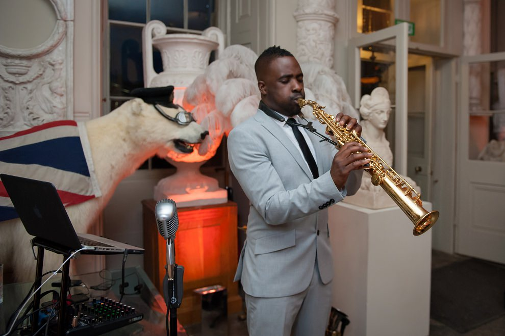 Jazz musician next to polar bear at Aynhoe Park