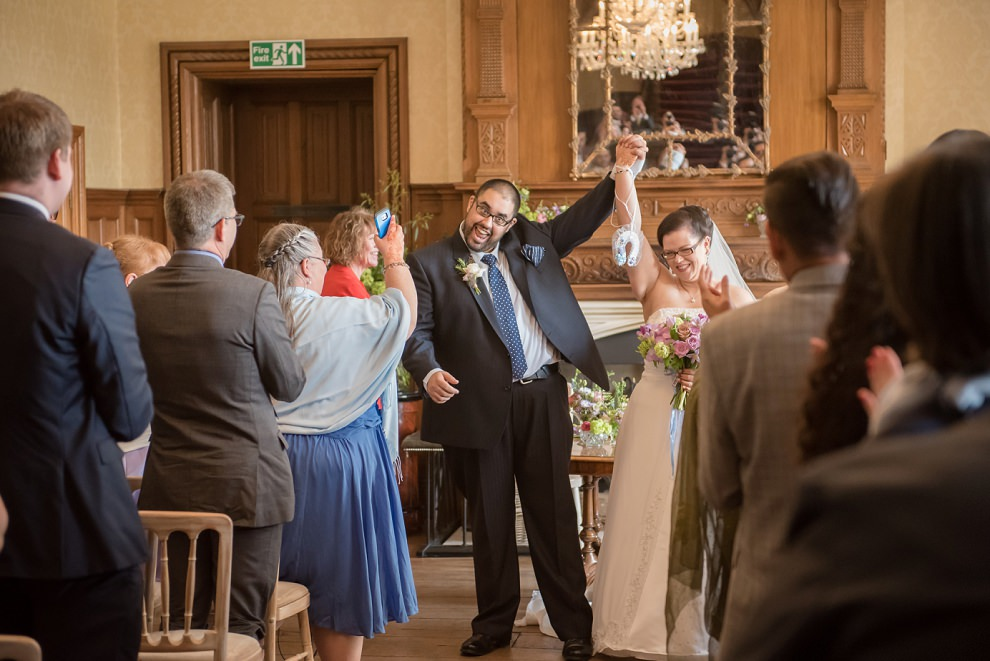 Happy couple at top of aisle after wedding ceremony