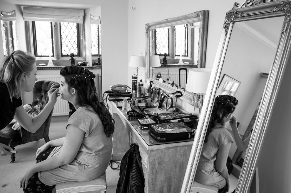 Black & white photo of bride having her make-up done