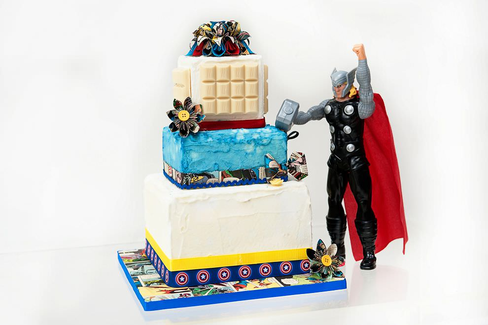 Thor with a geeky superhero wedding cake for comicbook fans