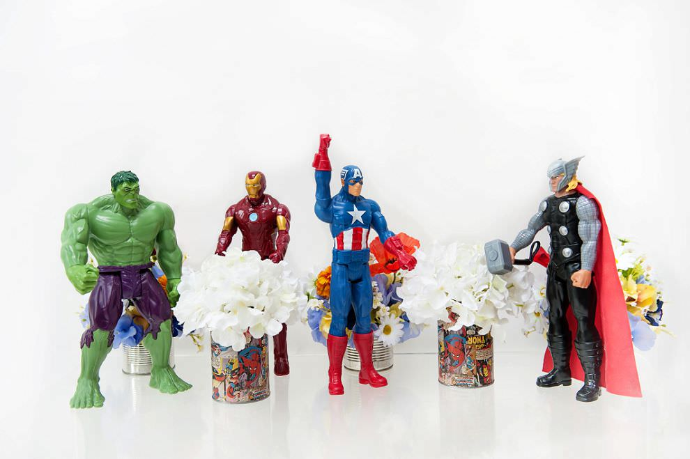 wedding decor flowers in tins covered in comic book pages
