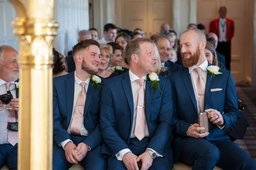 Groomsmen laughing at wedding