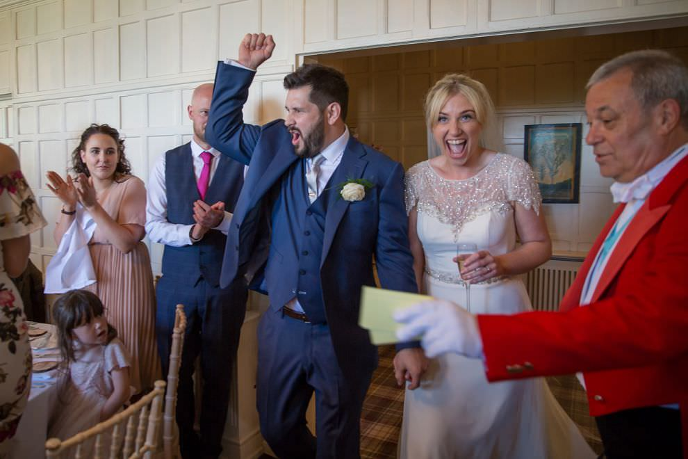 Bride and groom enter reception at Laura Ashley Hotel