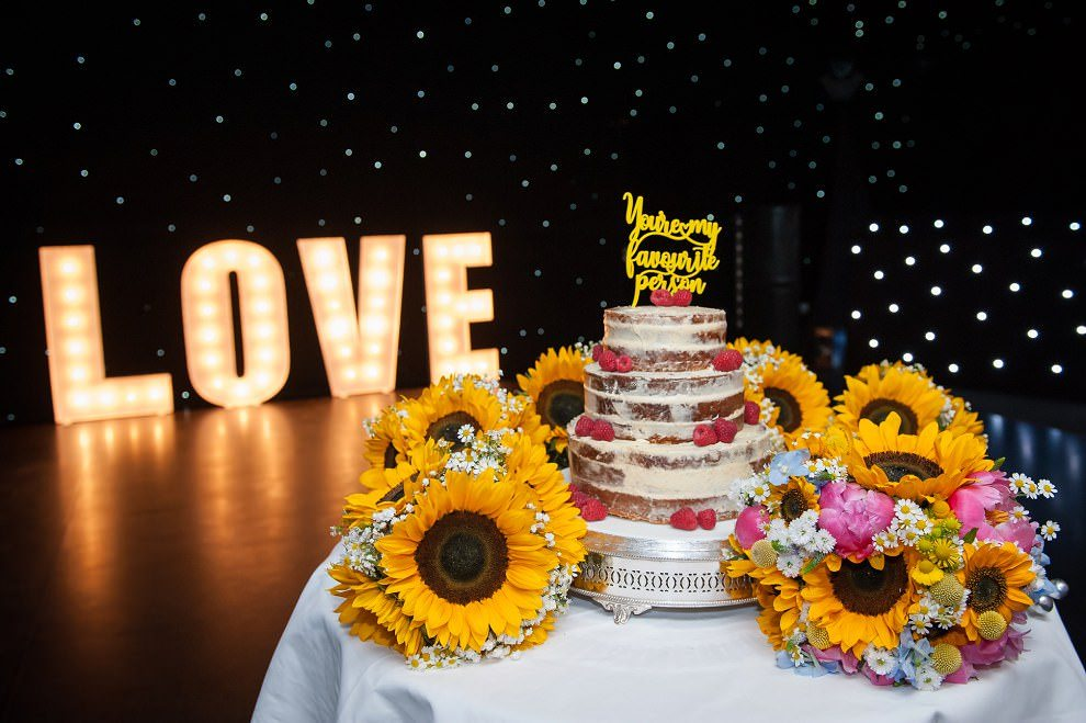 Naked wedding cake with LOVE sign