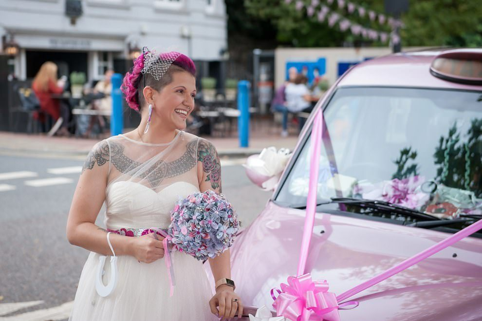 bride pink mohawk with pink taxi cab | Wedding photographers London