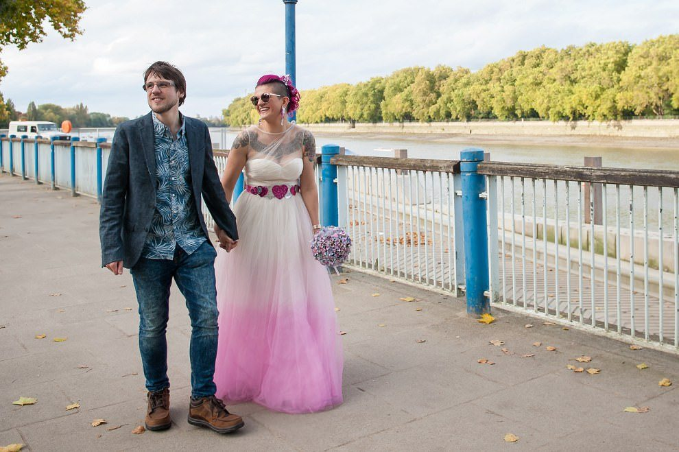 pink wedding dress with pink hearts belt | Alternative wedding photography
