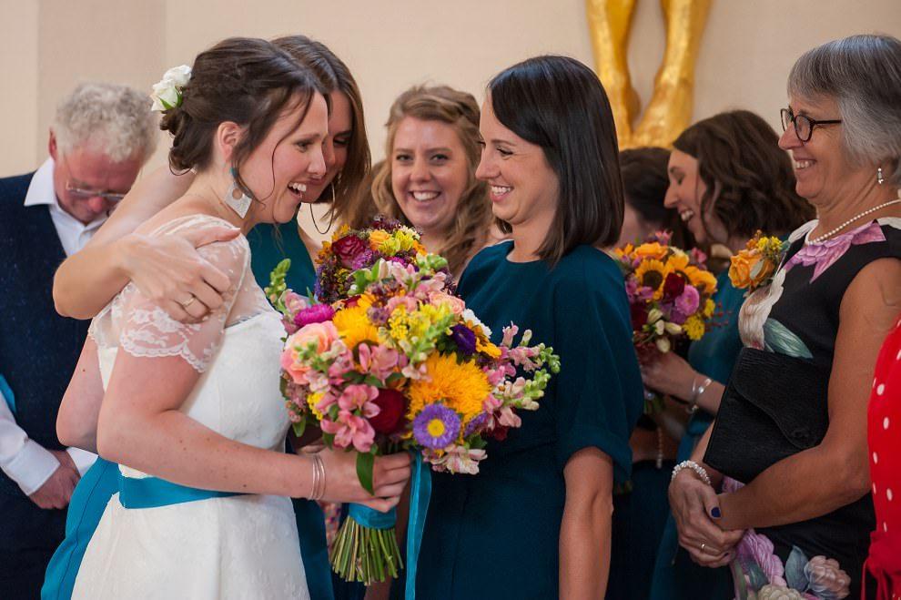 Bridesmaids hugging bride after ceremony | London wedding photographer