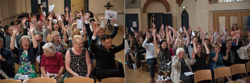 Guests singing at wedding singalong | Alternative wedding photographers UK