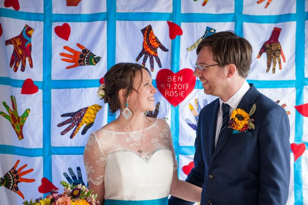Wedding couple with personalised quilt