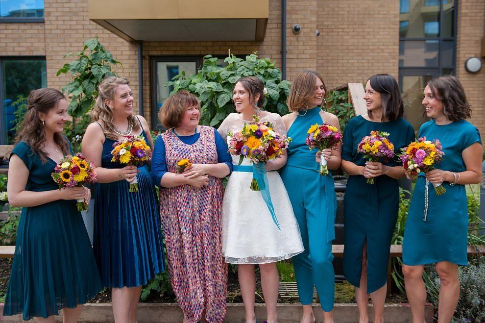 Blue mismatched bridesmaids dresses | Fun group photo bridal party