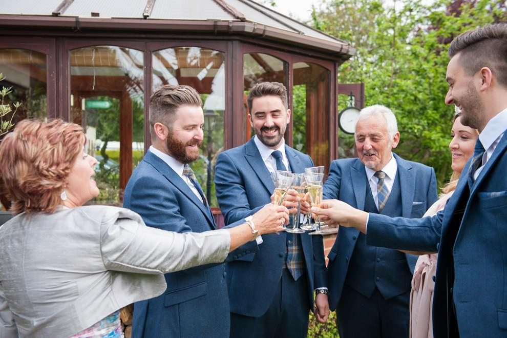 London wedding photographer | groom and family toasting before wedding