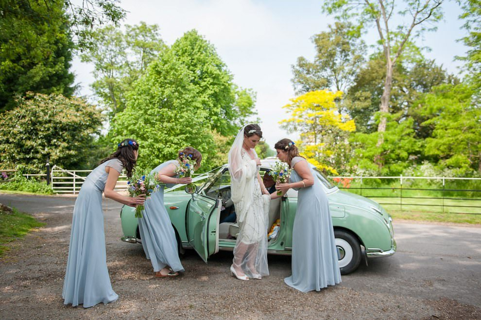 Bride arriving in vintage car at Preston Court St Mildreds Church