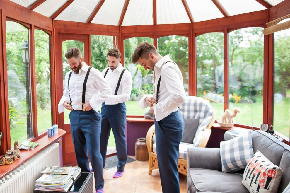 Groom and groomsmen getting ready at home