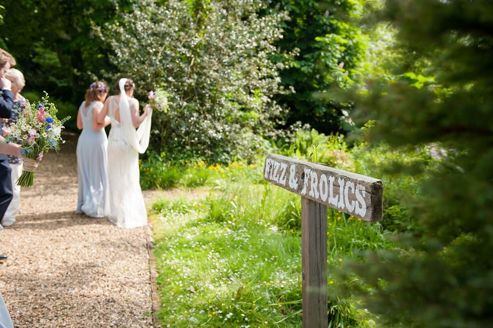 Wooden fizz & frolic sign at Preston Court wedding