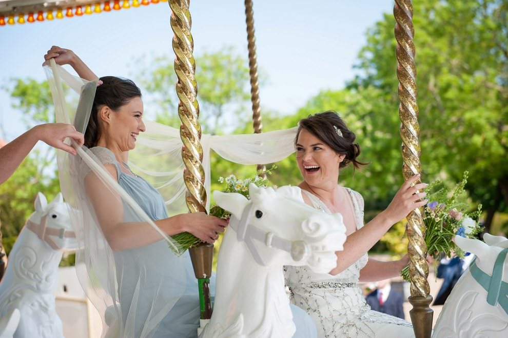 Bride & Bridesmaids on carousel at Preston Court wedding Kent