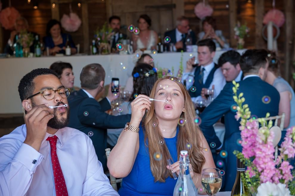 Guests blowing bubbles at Preston Court wedding Kent