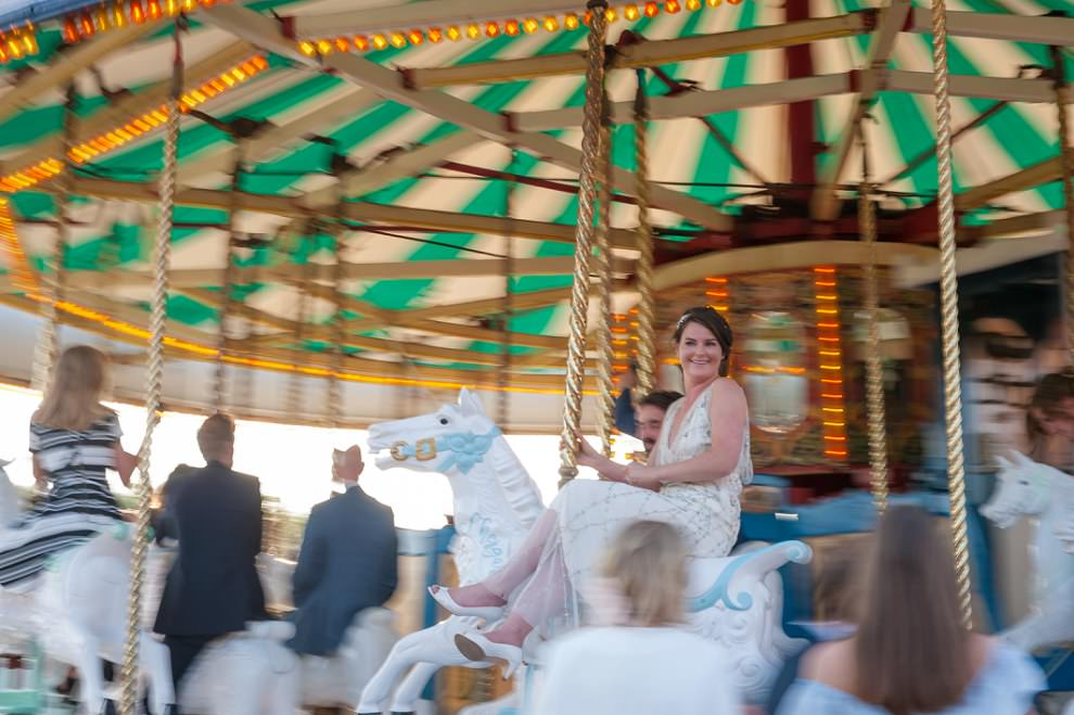Bride on carousel Preston Court | motion blur