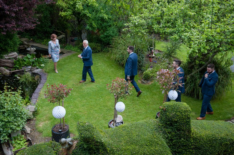 Alternative wedding photographer London | family walking through garden from overhead