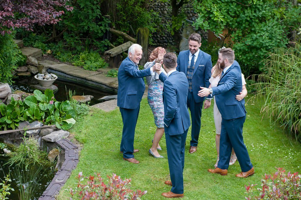 Quirky wedding photography - family hugging before Kent wedding