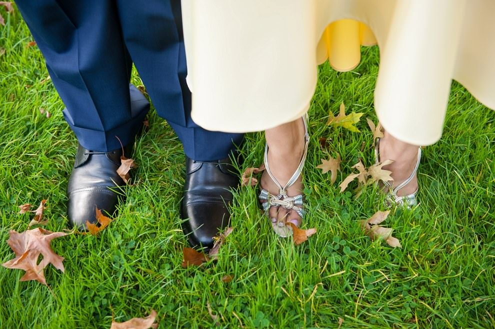 Bride and grooms shoes in grass at wedding