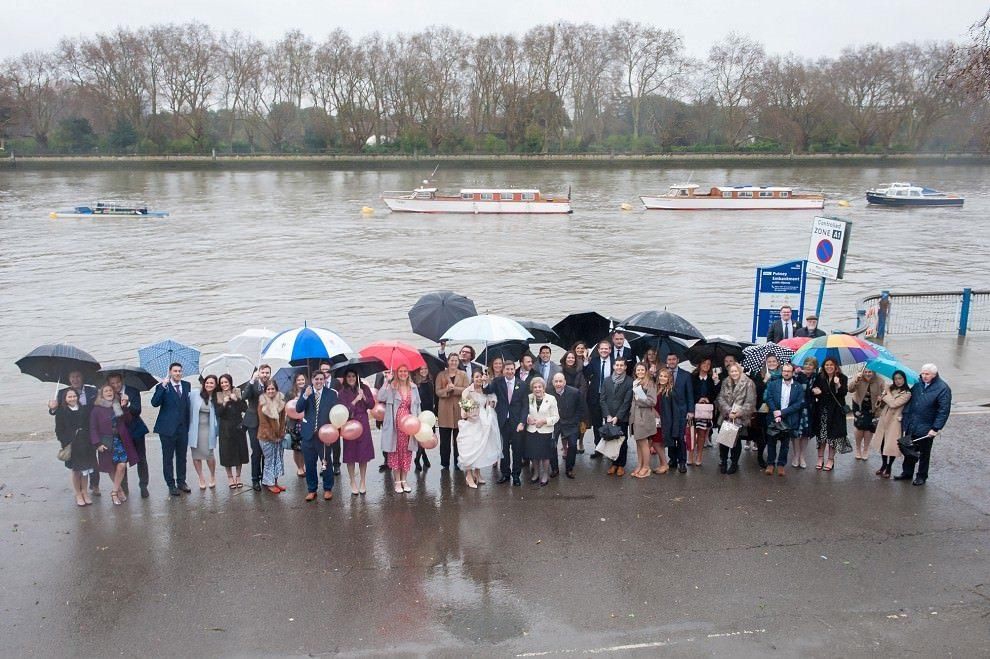 rainy wedding group shot London Rowing Club